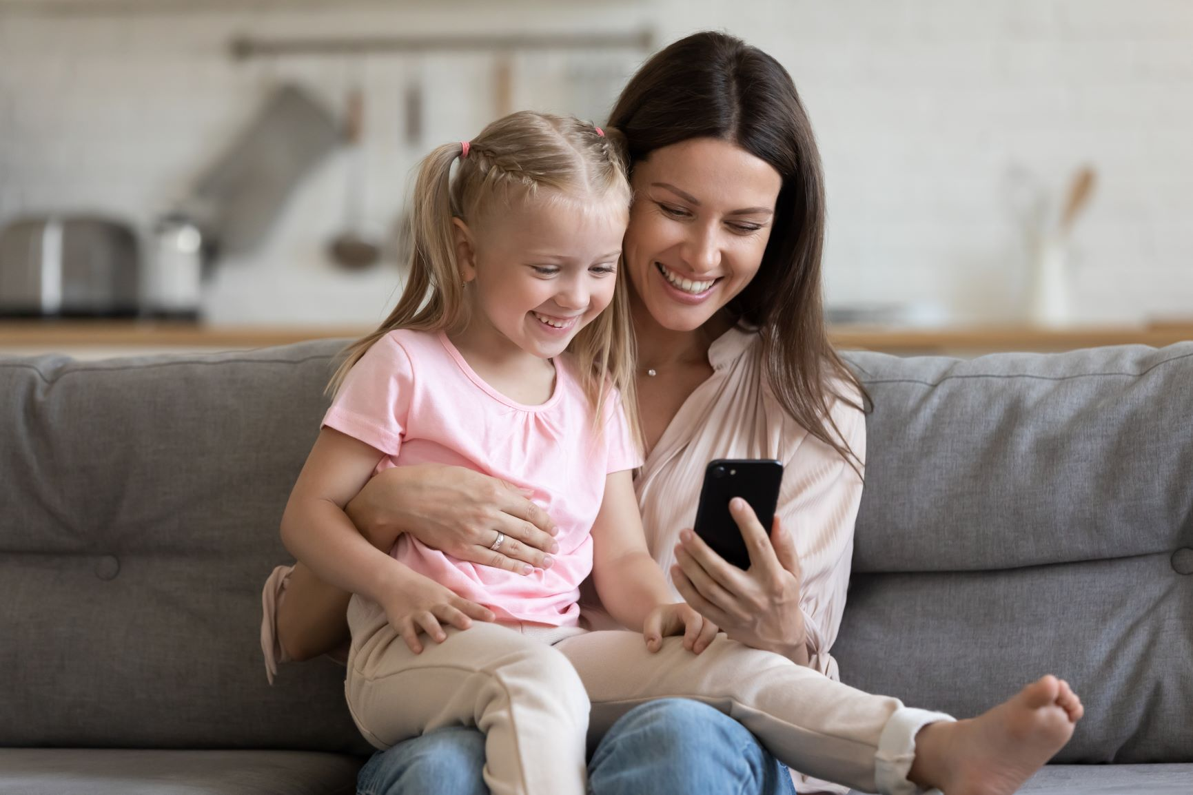 Mother and child looking telepsychiatry  app