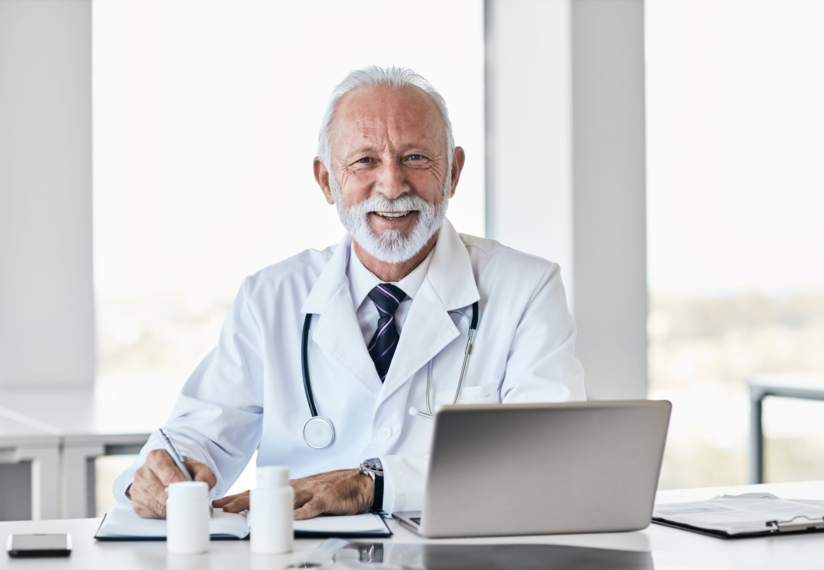Older doctor is satisfied to the care coordination platform and reports